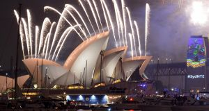 Fireworks erupt over Sydney's  Harbour Bridge and Opera House during the New Years Eve fireworks show. Photograph: AFP