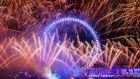 Fireworks light up the sky over the London Eye in central London during the New Year celebrations. Photograph: PA