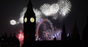 Fireworks light up the London skyline and Big Ben just after midnight on January 1st, in London, England. Photograph: Getty