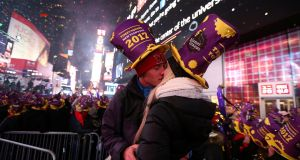 Revelers embrace at the start of 2017 at the New Year's celebration in Times Square. Photograph: Reuters