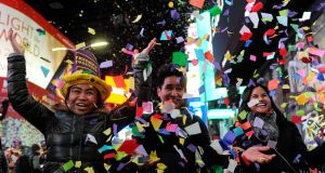 People play in confetti in Times Square  in New York. Photograph: Reuters