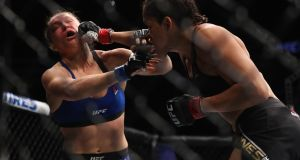 Amanda Nunes punches Ronda Rousey in their UFC women's bantamweight championship at UFC 207  in Las Vegas. Nunes defeated Rousey in 48 seconds and landed 27 strikes on the former queen of MMA. Photograph: Christian Petersen/Getty Images