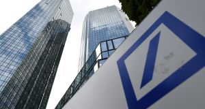 Deutsche Bank: will  keep  investment banking operations and ensure they comply with political and regulatory rules. Photograph: Arne Dedert/EPA