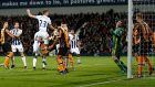 Gareth McAuley leaps to score West Brom's second in their 3-1 win over Hull. Photograph: Reuters/Matthew Childs
