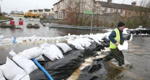 "Then councillor and now TD Kevin ""Boxer"" Moran helps with flood defences in  Athlone near the flooded River Shannon in  December  2015. File photograph: Brian Lawless/PA Wire"