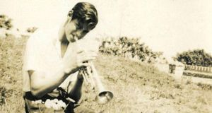 Ivor Browne playing the trumpet in the field beside the family home in Sandycove