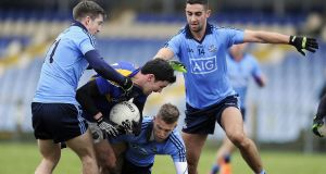 Longford's Francis McGee in action against Dublin's Jarleth Curley, Jonny Cooper and James McCarthy during last year's O'Byrne Cup clash. Photograph: Tommy Grealy/Inpho