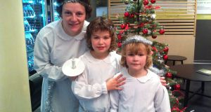 Emma Prunty with Maeve and Josie ready  for the  Santa Lucia procession at an Ikea store outside Florence.