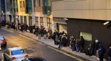 People  waiting for the Garda National Immigration Bureau to open on Burgh Quay in Dublin. Photograph: Cyril Byrne