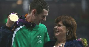 Michael McKillop receives his Gold medal in the Mens 1500m - T37 from his mother Catherine at the Olympic Stadium, London, in 2012. Photograph: John Walton/PA Wire