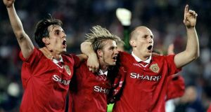 Gary Neville, David Beckham and Jaap Stam of Manchester United celebrate victory over Bayern Munich in the European Champions League Final in 1999. Stam returns to United as Reading boss this weekend. Photo: Ross Kinnaird /Allsport