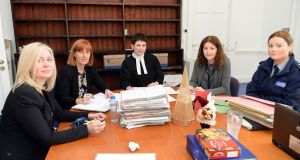 The Drug Treatment Court, with Justice Patricia McNamara (centre) and (from left) Louise Dwyer, court registrar; Hilda McDermott, DTC co-ordinator; Fiona Carolan, education co-ordinator; and Garda Catherine Ferry. Photograph: Eric Luke