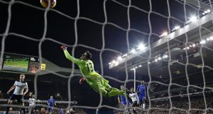 Chelsea's goalkeeper Thibaut Courtois is beaten by Delle Alli's header as Tottenham take the lead at White Hart Lane. Photograph: Adrian Dennis/AFP /Getty Images