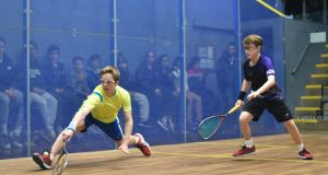 Ireland's Denis Gilevskiy  runs past Sam Osborne-Wylde of England during the under-13 final at the British Junior Squash Open.  Photograph: Steve Cubbins.