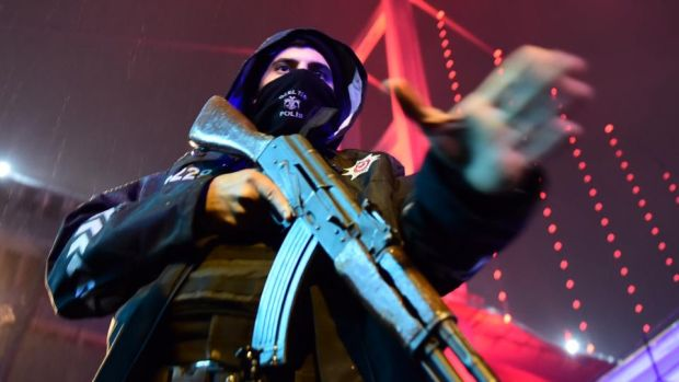 Reina attack: a policeman guards the nightclub where 39 people were killed on New Year's Day. Photograph: AFP