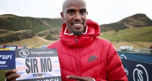 Sir Mo Farah in Holyrood Park prior to Saturday's Great Edinburgh XCountry in Scotland. Photograph: Jane Barlow/PA Wire