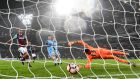 David Silva slots Manchester City's third in their FA Cup third round rout of West Ham. Photograph: Reuters/Toby Melville