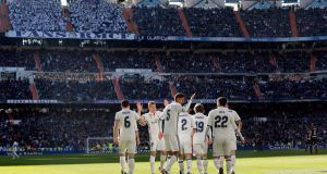 Real Madrid's players celebrate the opening goal against Granada scored by Isco during the La Liga clash at the Santiago Bernabeu. Photo: EPA