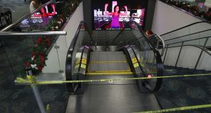 Police tape blocks access to the escalator that takes people from the baggage area of Terminal 2 in Fort Lauderdale-Hollywood International airport. Photograph: Joe Raedle/Getty Images