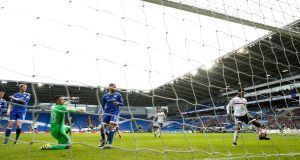 Fulham's Ryan Sessegnon scores his side's winner against Cardiff City at Cardiff City Stadium. Photograph:  John Sibley Livepic