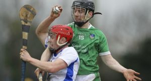 Daragh Lyons is tackled by  Graeme Mulcahy during Waterford's defeat to Limerick. Photograph: Inpho/Ken Sutton
