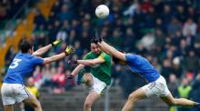 Meath's Graham Reilly kicks for goal as Jamie Snell and Ross O'Brien of Wicklow try to block during the Bord na Mona O'Byrne Cup match at Páirc Tailteann in Navan. Photograph: Colm O'Neill/Inpho