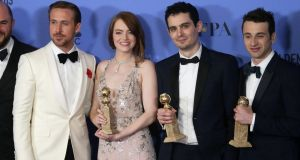 Ryan Gosling, Emma Stone, Damien Chazelle and Justin Hurwitz hold their awards at the annual Golden Globes awards ceremony. Photograph: Mike Nelson/EPA