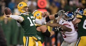 Aaron Rodgers threw a Hail Mary touchdown to help the Green Bay Packers get past the New York Giants. Photograph: NYT/Ben Solomon