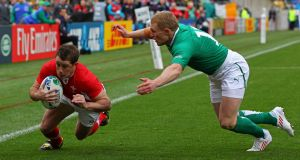 Former Wales winger  Shane Williams, seen here scoring during the World Cup quarter-final against Ireland in Wellington in 2011, will join Donegal club champions Glenswilly as part of 'The Toughest Trade'. Photograph:  Alex Livesey/Getty Images