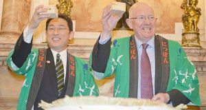 Minster for Foreign Affairs & Trade, Charlie Flanagan TD, and Japanese Foreign Minister Mr Fumio Kishida, crack open a barrel of Japanese Sake in a ceremony at Iveagh House , Dublin. Photograph: Eric Luke/The Irish Times