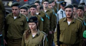 Israeli soldiers stand still during the funeral of Israeli soldier Yael Yekutiel at the Kiryat Shaul Military Cemetery in Tel Aviv, Israel, January 9th, 2017. Yekutiel was one of the four Israeli soldiers killed in a truck attack in Jerusalem on  January 8th. Photograph: Abir Sultan/EPA