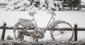 A snow covered bicycle stands in Wiesbaden, central Germany, on Tuesday. A icy weather warning is in place for parts of Ireland from Wednesday. Photograph: Getty