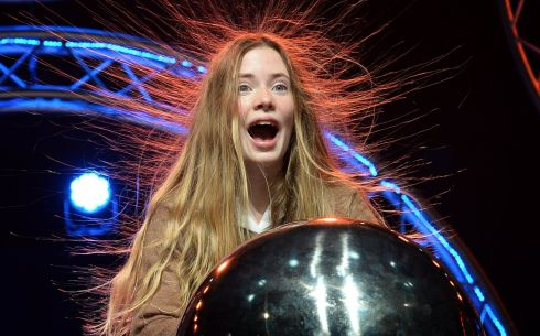 FUTURE SHOCK: Margot Moore, a first-year student from Loreto Foxrock, has a hair-raising experience, at the launch of the BT Young Scientist & Technology Exhibition, at the RDS. Photograph: Eric Luke/The Irish Times