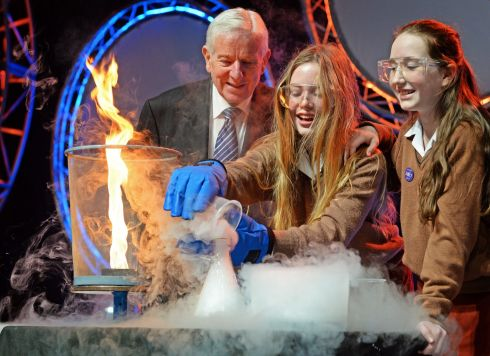 YOUNG SCIENTIST EXHIBITION: Dr Tony Scott, co-founder, with Aimee O'Neill and Margot Moore, first-year students from Loreto Foxrock, at the launch of the BT Young Scientist & Technology Exhibition, at the RDS. Photograph: Eric Luke/The Irish Times
