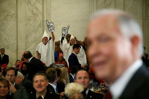 SESSIONS PROTEST: Protesters dressed as Klansmen disrupt the start of a Senate judiciary committee confirmation hearing for US Attorney General-nominee Senator Jeff Sessions on Capitol Hill in Washington. The conservative senator faces concerns over how committed he would be to civil rights. Photograph: Kevin Lamarque/Reuters