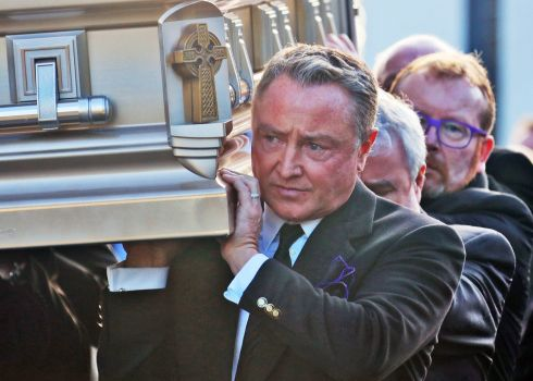 FLATLEY FUNERAL: Michael Flatley carries the remains of his mother at St Moling's Church, Glynn, Co Carlow at her funeral. Photograph: Colin Keegan/Collins Dublin