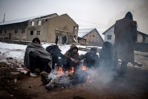 BELGRADE: Migrants warm up around a fire at a makeshift shelter at an abandoned warehouse in Belgrade as temperatures dropped to -15 degrees overnight. Photograph: Andrej Isakovic/AFP/Getty Images