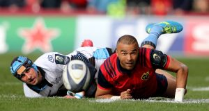 Munster's Simon Zebo with Peter Murchie of Glasgow Warriors:  sides meet in  crunch  match  in Scotstoun on Saturday. Photograph: Dan Sheridan/Inpho