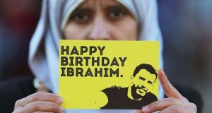 Somaia Halawa, sister of Ibrahim Halawa, holds up a card during a Dublin protest wishing him well at the time of his 21st birthday. He has been incarcerated in Egypt since the age of 17. File photograph: Getty Images