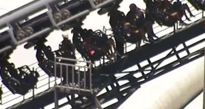 Rescue help  people stuck in the Arkham Asylum roller coaster ride. Photograph: Reuters