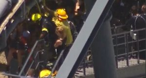 More than twenty people were trapped for almost two hours at the top of the  roller coaster ride in Australia. Photograph: Reuters