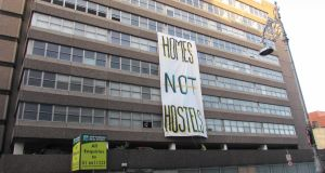 Occupiers of Apollo House unfurl a banner reading 'Homes not hostels' on Wednesday morning. Photograph: Dean Ruxton