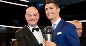 Portugal's Cristiano Ronaldo, right, poses with FIFA President Gianni Infantino after winning The Best FIFA Men's Player award during the The Best FIFA Football Awards 2016 held in Zurich, Switzerland. Photo: Ennio Leanza/Keystone via AP