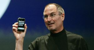Steve Jobs: The then chief executive of Apple  displays a  new iPhone in San Francisco on January 9th, 2007. Photograph: Reuters/Kimberly White