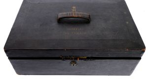 "Lot 203, a black leather box embellished with ""the gilt-tooled, crowned Royal Arms of George V and 'SECRETARY - MR LEMASS' to the lid"" made by A. Armstrong and Co. Ltd., Dublin, is estimated at €250-€350 in  Whyte's auction"
