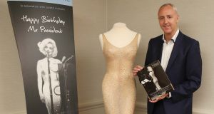 Julien's Auctions co-owner Martin Nolan with the dress owned by Marilyn Monroe which the Los Angeles-based auction house sold for $4.8 million. Photograph: Robbie Reynolds