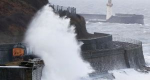 Waves crash against the sea wall near Whitehaven in Cumbria, UK on Wednesday.  Photograph: Owen Humphreys/PA Wire