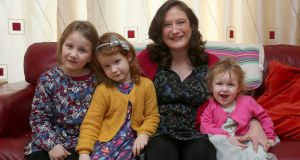 Anna-Maria Kirrane at home with her daughters Tara (5), Aoife (4) and Ashling (2). Photograph: Joe O'Shaughnessy