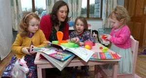 Anna-Maria Kirrane at home with her daughters Aoife (4), Tara (5) and Ashling (2). Photograph: Joe O'Shaughnessy