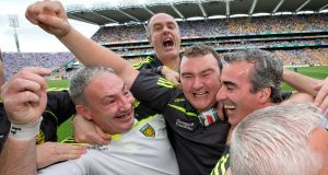 Donal Reid (left) and Joe McCloskey celebrate with Donegal manager Jim McGuinness after the victory over Dublin in the 2014 All-Ireland semi-final at Croke Park. Photograph: Morgan Treacy/Inpho